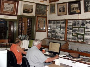 Research area, where documents are being transcribed or brought up to assist visitors.